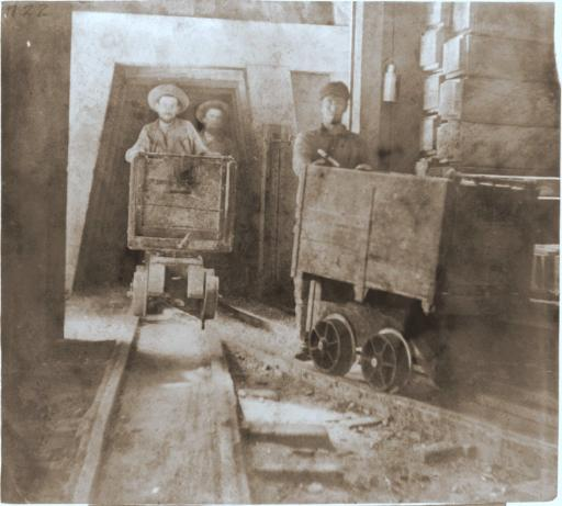Gould & Curry Mine: Miners ride cars through a tunnel at the Gould & Curry Mine in Nevada in 1866.