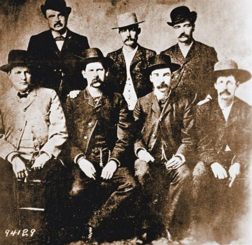 Dodge City Peace Commission: Members of the Dodge City, Kansas, Peace Commission, from left to right: Chas. Bassett, W. H. Harris, Wyatt Earp, Luke Short, L. McLean, Bat Masterson, Neal Brown. The photograph was taken by Camillus S. Fly in 1890.    Related: The Notorious Luke Short S