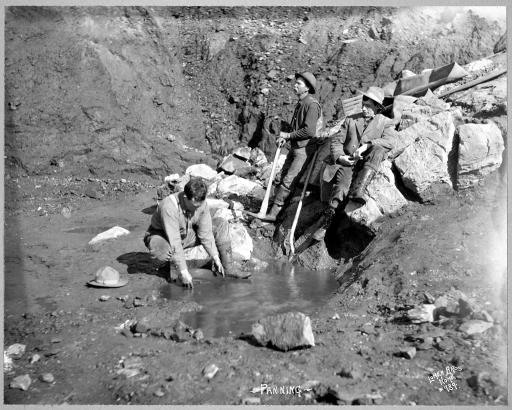 Panning for gold: c1900: Men panning gold in Alaska between 1900 and 1927.